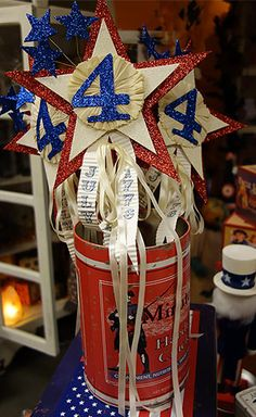 Dee Foust 4th of July Wands in a tin patriotic advertising can.