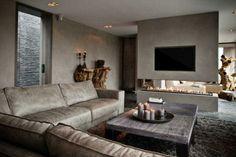 Stijlvolle woonkamer, de wanden zijn voorzien van PTMD verf. Bank, salontafels en sidetable van PTMD via Pracht Interieur