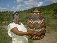 Phumelele Mhcongo with the beautiful basket she wove