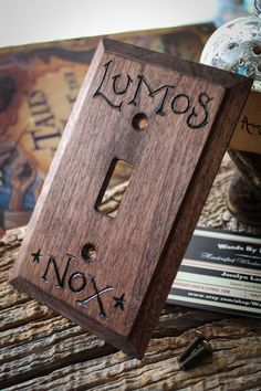 Lumos-Nox Harry Potter light switch wall panel by MoonAndPine