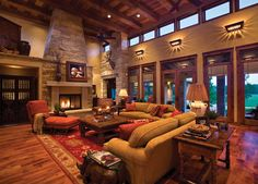 I like the sandstone fireplace and furniture arrangement. Oh, hell, I like everything in the room!