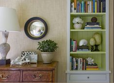 grasscloth wallpaper in bedroom detail with inside shelving painted green