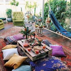 Mix and match whatever looks stunning to you. Bohemian style decoration is all about your choice. Use swing, different style of furniture, pots, rugs, cushions and much much more. The beautiful wooden deck is also increasing the beauty of this boho style backyard decoration.