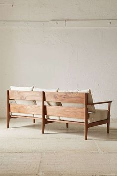 Paxton Sofa - Urban Outfitters. Gorgeous use of wood and simple, clean lined design.