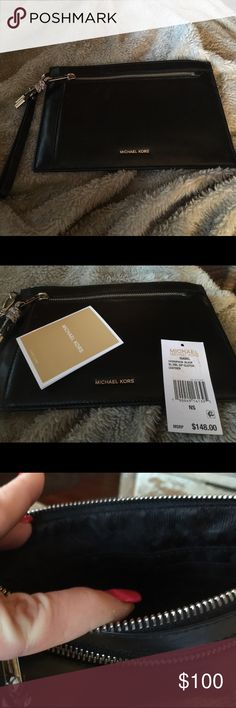 Michael Kors clutch NWT   Black XL DBL Zip leather clutch  back pocket  zipper   Inside has divider and card holders    Very nice and classy KORS Michael Kors Bags Clutches & Wristlets
