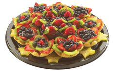 Decadent Dessert Platter - Puff pastry flower shells filled with a real whipped cream and Bavarian cream blend and topped with fresh fruit and Belgium chocolate cups filled with chocolate mousse.