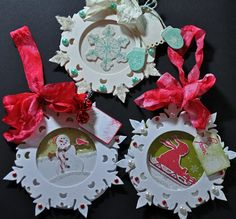 Damask Snowflakes, In the Meadow, clear cardstock. Popped up to create a shaker-esque tag. Love the fluffy bows with seam binding.