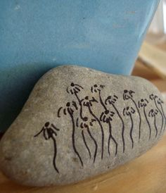 draw on rocks!!  http://www.apartmenttherapy.com/drawing-on-rocks-112751