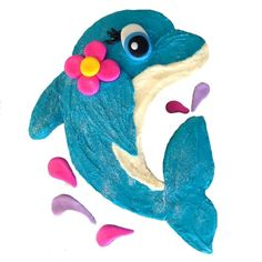 Make a Splash with this gorgeous dolphin... Your DIY Cake Kit contains all you need to bake and decorate: 	Cake Mix 	Icing Mix / Food Colouring (if required) 	Pre-Coloured Fondant 	Glitter 	Pre-greased Disposable Baking Box 	Silver Cake Display Board 	Fondant Icing Kit – Glove