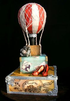TV / Movies / Celebrity - My steampunk wizard of Oz wedding cake. Sugar veil net, modelling chocolate shoes and tin man heart, map of oz hand drawn with edible ink, hot air balloon basket made done with royal icing piped into basket weave Cakes For Men, Just Cakes, Cupcakes, Cupcake Cakes, Beautiful Cakes, Amazing Cakes, Sugar Veil, Hot Air Balloon Cake, Cake Wrecks