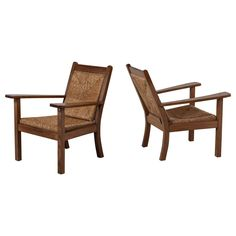 Pair of Willi Ohler Chairs in Oak and Original Rush, Germany, 1920s   From a unique collection of antique and modern armchairs at https://www.1stdibs.com/furniture/seating/armchairs/