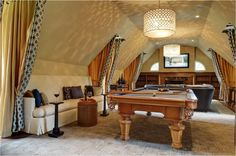 Astounding Room Design for Billiard Area: Divine Contemporary Attic Interior Design For Billiard Room Long White Fabric Sofa And Colorful Cushions Yellow Curtains Modern Pendant Lamp Also Shade Carpet Floor Wooden Fireplace With Wall Bookcase Also Large Tv ~ ellabb.com Home Accessories Inspiration