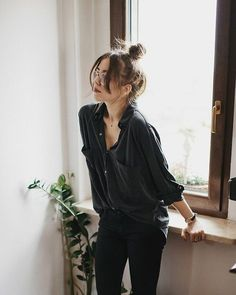 A loose black silk blouse ups the ante on casual day or casual office attire with black leggings or skinny denim, and low heel ankle strap pumps with a top knot. Messy is out when it comes to an updo, just add well-trimmed bangs to it, and look sleek yet more laid back at work.