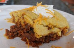 Beefy cornbread casserole. I didn't have regular chili powder so I used chipotle chili powder with a dash of cayenne, added some tobacco to the ketchup mix, and cheese to the cornbread mix. Yum!