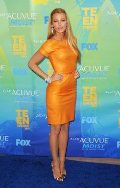 blake lively- I need an orange leather dress now lol