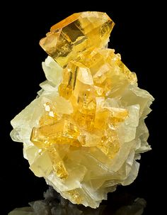 Golden Barite (Sulfate) on Calcite (Carbonate) from the Meikle Mine in Elko County, Nevada.