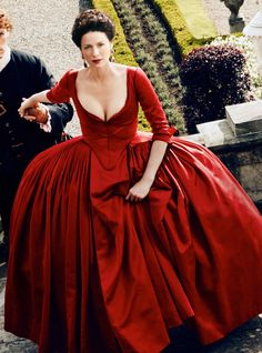 Outlander (2016) - Caitriona Balfe as Claire Fraser wearing a scarlet red panier dress with corseted bodice and plunging neckline.  The costumes were designed by Terry Dresbach