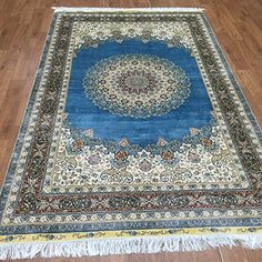 Camel Carpet Hand Knotted Blue Central Medallion Authentic Persian Turksih Silk Carpet Rug 5'x8' http://www.amazon.com/dp/B01DP9UO5S/ref=cm_sw_r_pi_dp_NKbixb0ASYYWW