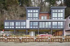 For the exterior of Dale Schwarzmiller and Sally Isaiou's 1,900-square-foot home, Dan Nelson, principal, and project architect Matt Radach of Designs Northwest Architects and contractor Mike Waite of Waite Construction used tight-knot western red cedar and corrugated metal. (Benjamin Benschneider/The Seattle Times)