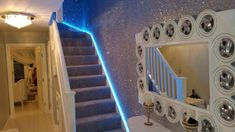 Silver #glitterwallpaper running alongside #LEDlighting on the stairs. Maximise the effect of #Glitterwallcoverings in your home by the use of #spotlights or LED's. For samples, information and requests, click through..