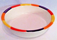This is a retired white extra large serving bowl with the tangerine tones decal on the rim, which has alternating tangerine, sunflower, persimmon and plum color blocks along the rim. It is an awesome retired piece, the tangerine tones decal adds a little extra Fiesta flavor!   eBay!