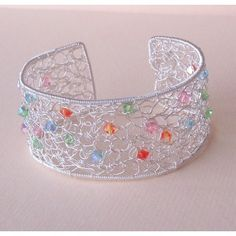 Lovely example of filigree style beaded wire crochet.