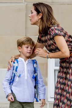 The occasion appeared a little overwhelming for the young prince, whose eyes filled with t...