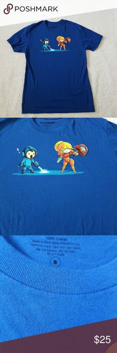 Nintendo Samus & Mega-Man t shirt Nintendo Samus and Mega-man t shirt • New without tags; never been worn •This shirt features Mega-Man seeing Samus for the first (and he's ultimately surprised!) 😆😆😆 •Soft cotton makes this shirt perfect for lounging around!  Measurements to come! teeturtle Shirts Tees - Short Sleeve