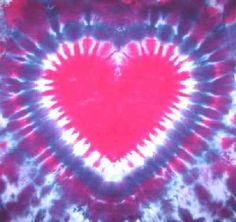 This website has a step by step guide on how to tie-dye around a heart design.