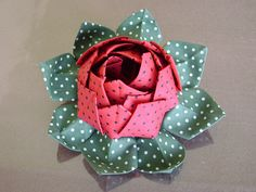I bet this could be made with fabric.  love this flower.