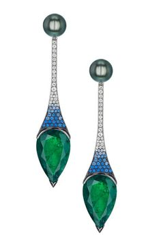 These very much have a peacock feel to them...GEMFIELDS Emerald earrings by Shaun Leane.