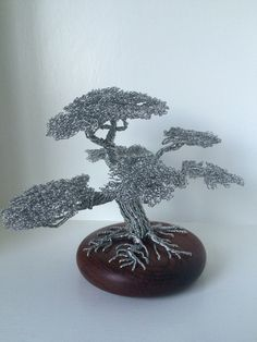 Beautiful Wire Tree Sculptures by Clive Maddison http://designwrld.com/wire-tree-sculptures-by-clive-maddison/