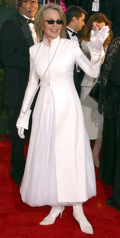 Diane Keaton wears an all-white ensemble of dress, overcoat, satin gloves and lace boots at the Golden Globes in 2004.