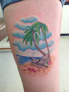 A cute looking beach tattoo on the arm. The colors are all light and pleasing to the eyes making the laid back aura of the beach shine through.