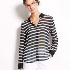 Ann Taylor Sail Striped Blouse Preppy stripes in rich neutral colors make the grade. Add a cami beneath for more coverage. Point collar. Long sleeves with button closure. Hidden button front. Shirttail hem. Ann Taylor Tops Button Down Shirts