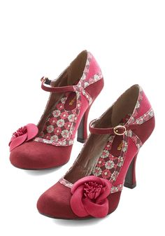 How will you style these buckled Mary Janes today? You could pair their dual hues of wine-red and magenta with coordinating nature-inspired colors, or sport their ivory-touched fabric floral trim to accent a bright ensemble. Either way, the off-centered rosettes and stacked heels of these vegan faux-suede shoes are gorgeously eye-catching!
