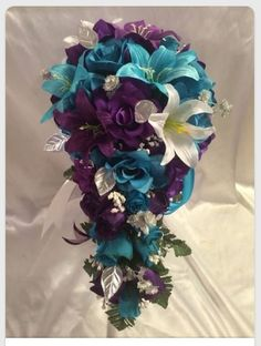 I know this is a bouquet for a bride but I think a hanging basket with these colors would be beautiful!