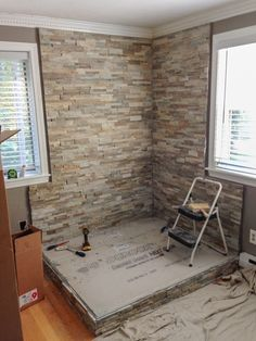In the image above, the homeowner is covering the wall with non-combustible rock and the hearth with tile. Description from mobilehomeliving.org. I searched for this on bing.com/images