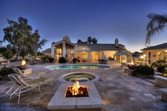 Huge backyard with firepit and glowing pool and spa.  Scottsdale Arizona