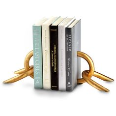 Cyan Design Goldie Locks Bookends (350 ILS) ❤ liked on Polyvore featuring home, home decor, small item storage, cyan design, gold home decor, window ledge, gold home accessories and gold bookends