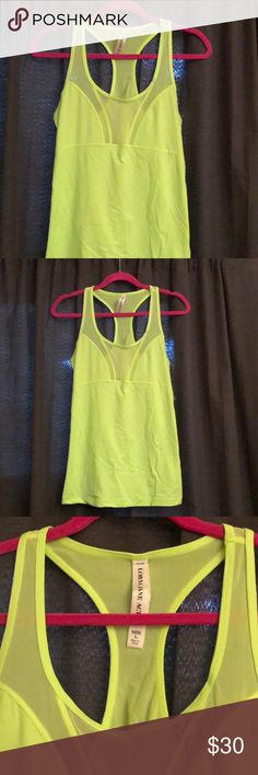 Lorna Jane activewear tank top Bold, bright, functional! It's a neon green color. Fitted racer back top with a front and back mesh neckline. Loved it but Lorna Jane runs too long on me in a size large. I'm 5'4. Never worn from a few seasons back so still in great condition. Anyone who is as obsessed with activewear as I am will love it!  All their tops start around $60 and go up. Expensive🙄 Lorna Jane Tops Tank Tops