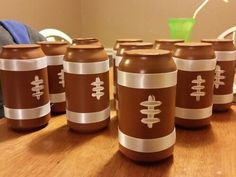 Made noise makers for my boys playoff game this weekend. Go blackhawks! ! #80 They turned out so cute! I spray painted some dr pepper cans, wrapped them with ribbon, and painted laces on. I filled the inside with dry pinto beans then covered the top with a piece of cardboard.