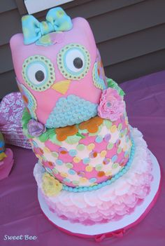 1st Birthday Owl - I was so excited to make my first owl cake! So much inspiration from all the toy owl plushies the Mom sent me that she had bought for the party. I changed my mind a gazillion times on this, but this is my final result. Bottom tier is vanilla chocolate chip, middle tier is a double barrel vanilla almond cake and the owl is a combination of those two flavors. All iced in vanilla buttercream icing and decorated in mmf. Completely edible!