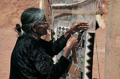 Photograph:A Navajo woman in Monument Valley, Utah, weaves a rug in much the same way as her ancestors have over the centuries.