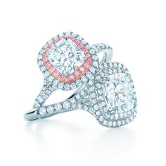 Tiffany Soleste® diamond engagement rings, from top: With fancy pink diamonds, with round brilliant center stone