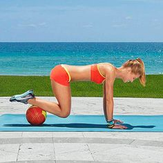 The High Plank Roll- Start in full push-up position with hands shoulder-width apart on ground directly under shoulders and legs extended behind you, ankles resting on top of a soccer ball. (No ball? Place toes atop a rolled-up towel on a wooden or other smooth floor surface to allow feet to slide.) Bring knees in toward chest, rolling with ankles on ball throughout.   Roll feet back to start position. Repeat for 1 minute. #shoulders #back #arms #abs #workout