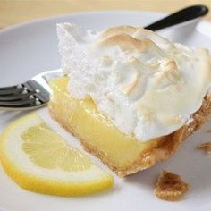 Grandma's Lemon Meringue Pie Recipe and Video - Fresh lemon juice and lemon zest make this lemon meringue pie filling tart and lovely. And when it's poured into a waiting crust, topped with billows of meringue, and baked, it's downright dreamy. Potluck Desserts, Lemon Desserts, Lemon Recipes, Pie Recipes, Just Desserts, Delicious Desserts, Dessert Recipes, Cooking Recipes, Dinner Recipes
