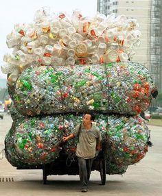 plastic bottles recycle carry cart man drag empty