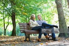 Stock Photo : Affectionate mature couple sitting on a park bench