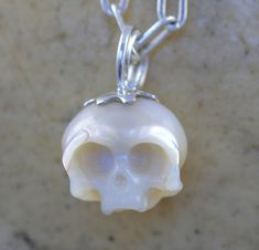 Carved Pearl Skull on Sterling Silver Necklace by ArloEdgeWalker
